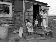 Soon after joining the Home (now North American) Mission Board, Don Rutledge spent weeks covering the daily lives of Alaskan Eskimos above the Arctic Circle. Here, a family waits for visitors to arrive at their home.